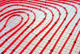 Zalety i wady instalacji wodnego ogrzewania podłogowego
